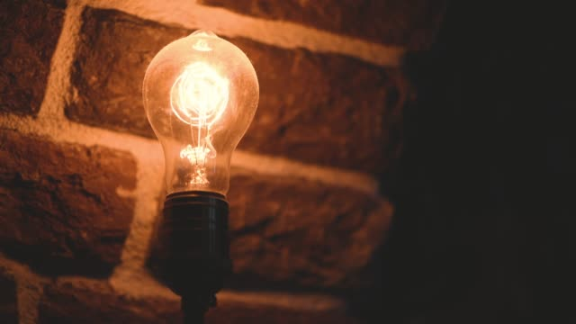 Vintage filament  bulb lighting Vintage bulb lighting against brick wall low lighting stock videos & royalty-free footage