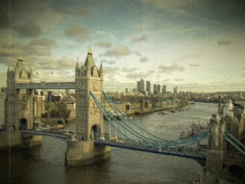 Vintage Film shot of London's Tower Bridge. NTSC, PAL An effected shot made to look like an old 8mm film, of London's Tower bridge. 19th century style stock videos & royalty-free footage