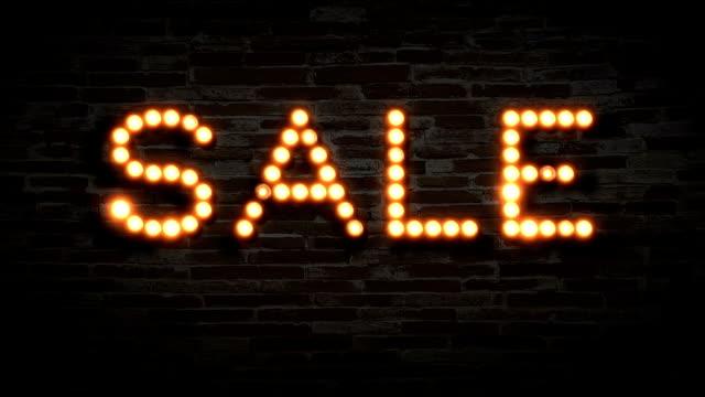 vintage light bulb Sale Sign with flicker loop animation on dark brick background