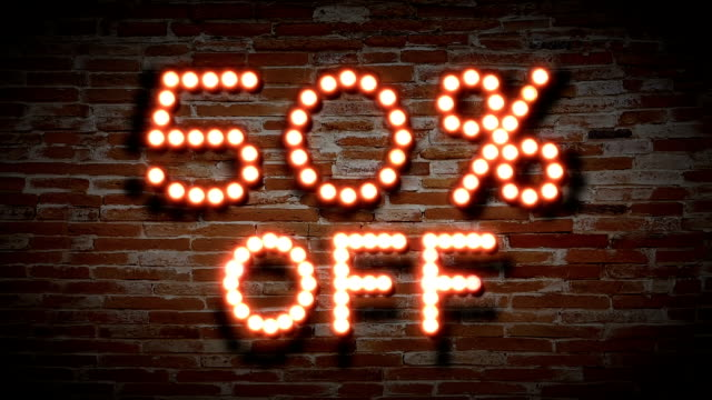 vintage light bulb sign with 50 percent off word on red brick wall