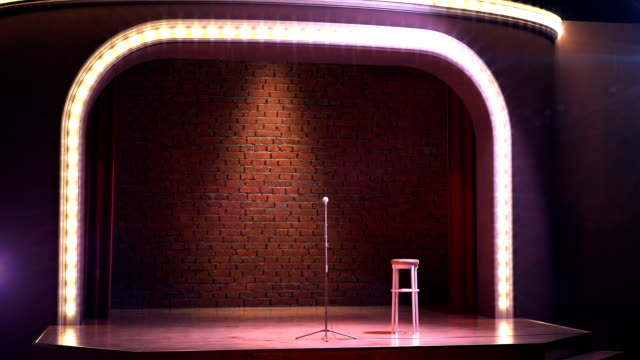 Vintage microphone on empty comedy club stage video