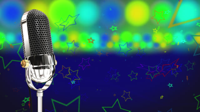 Vintage microphone on microphone stand with glowing circles and stars on a blue background video