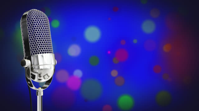 Vintage microphone on microphone stand with glowing circles on a blue background video