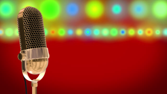 Vintage microphone on microphone stand with glowing circles on a red background video