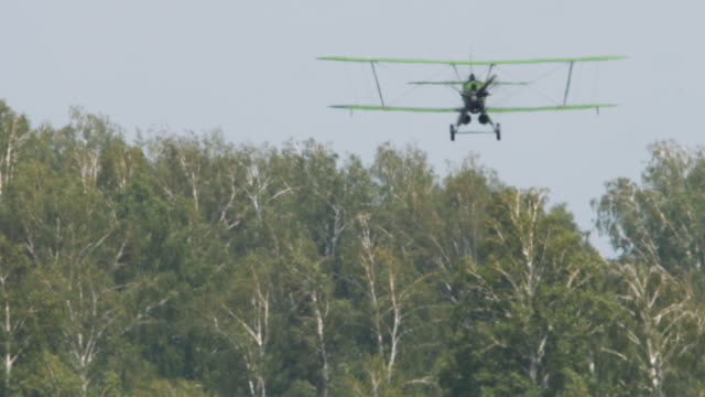Vintage military biplane Vintage biplane aircraft approach before landing. Airshow at the Mochishe aerodrome UNNM airfield stock videos & royalty-free footage