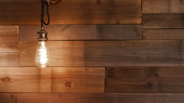 Vintage Modern Light Turns Off and On with Wood Wall static shot of a modern vintage light on a wall of reclaimed wood. Light turns on and off household fixture stock videos & royalty-free footage