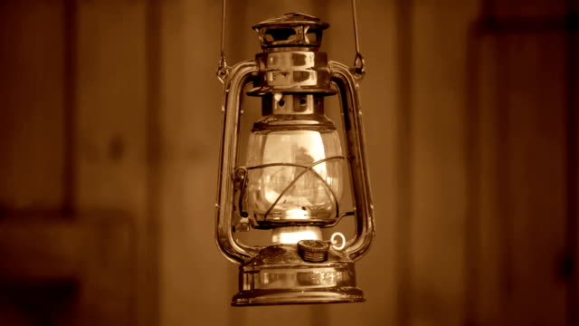 vintage oil lamp rocking (sepia toned / wild west style) video