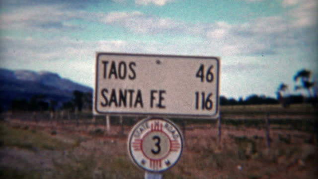 TAOS, NEW MEXICO 1955: Vintage road signs of New Mexico while on road trip holiday.