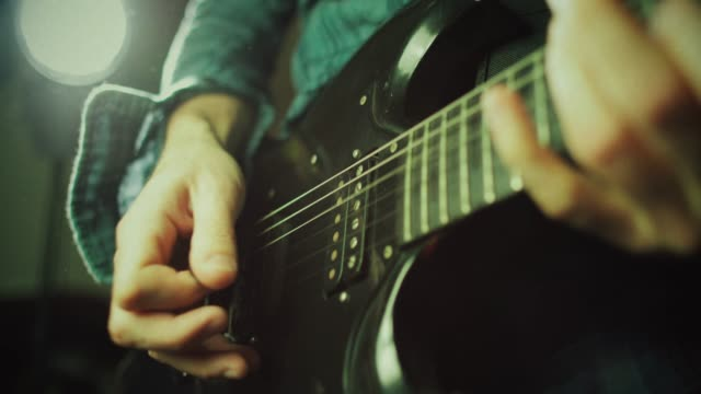 Vintage rock guitarist playing guitar Vintage rock series: guitar player rock music stock videos & royalty-free footage