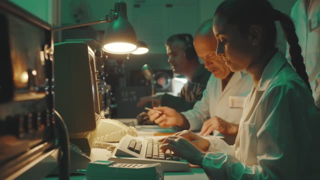 vintage sci-fi scientists working in a operation room - obsoleto video stock e b–roll