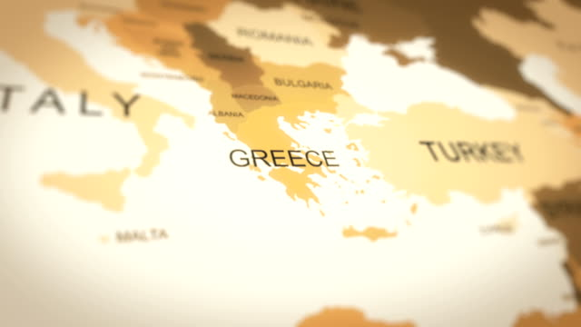 4k vintage sepia colored world map, zoom in to asia animation (greece) - grecia stato video stock e b–roll