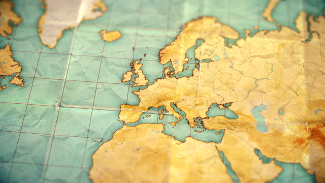 vintage sepia colored world map - zoom in to Europe - blank version video
