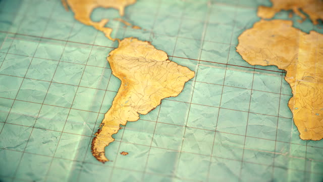 vintage sepia colored world map - zoom in to South America - blank version video