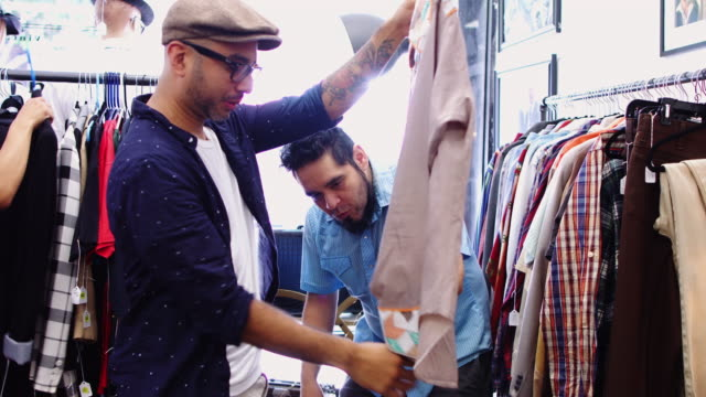 Vintage Store Owner Showing Shirt to Customer video