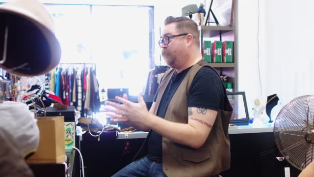 Vintage Store Owners Chatting With Customers video
