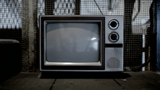 Vintage television in freight elevator