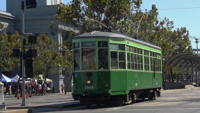Vintage trolley car leaving the station