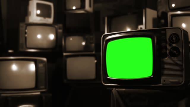"Vintage TV with Green Screen Over Many Old Tvs. Sepia Tone. Zoom Out. Vintage TV with Green Screen Over Many Old Tvs. Sepia Tone. Zoom Out. You can Replace Green Screen with the Footage or Picture you Want with ""Keying"" Effect (Check out Tutorials on YouTube). Full HD. hd format stock videos & royalty-free footage"