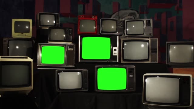 Vintage TVs Turning On Green Screen. Zoom In.