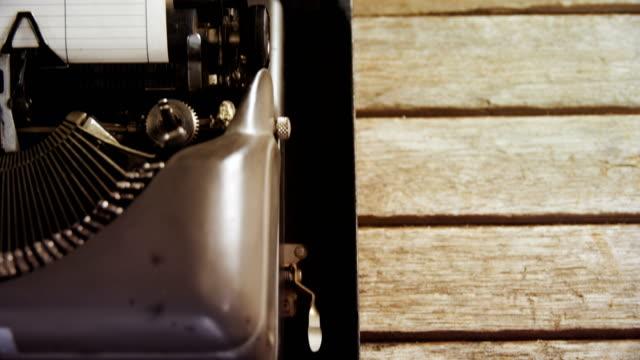 Vintage typewriter and black coffee on wooden table 4k video