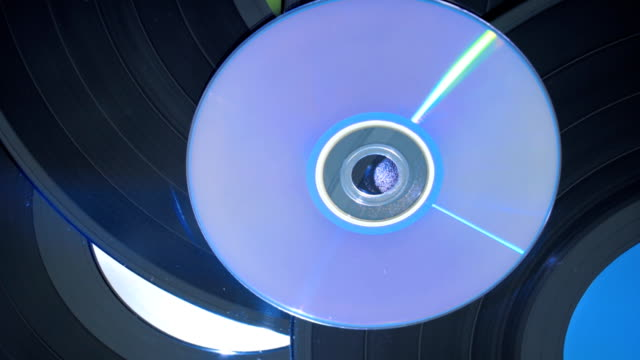Vinyl disc together with a compact disc - feel the difference video