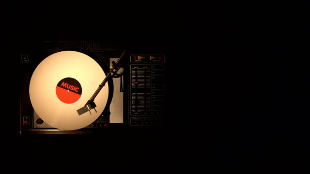 vinyl record on the pleer. plays a song from an old turntable. - disco audio analogico video stock e b–roll
