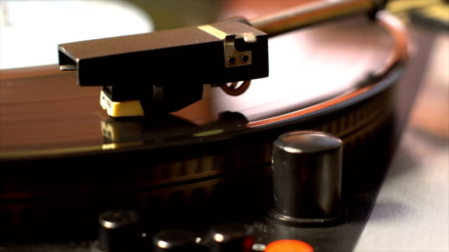Vinyl record on the pleer. Plays a song from an old turntable. video
