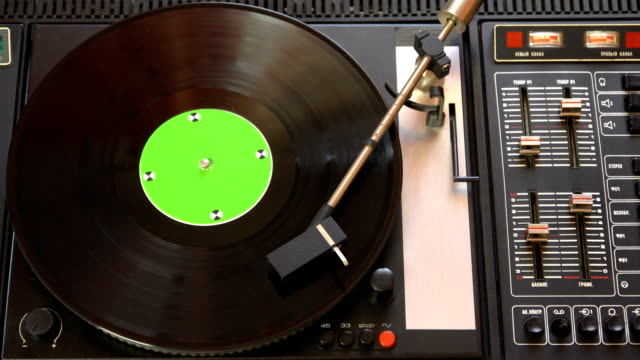 Vinyl record pleer. Plays song from an old turntable 4k top view. video