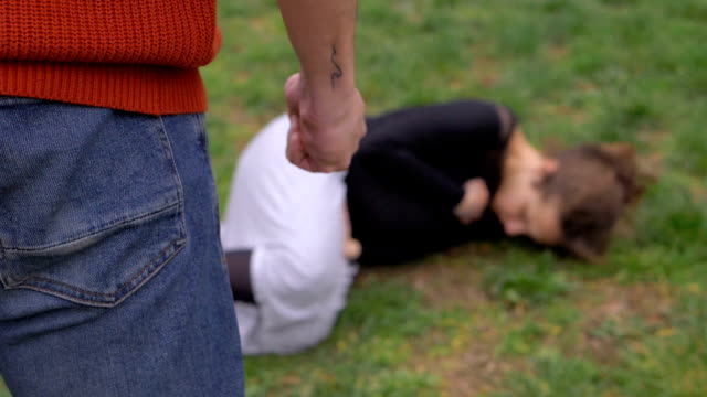Violence, aggression against women.Man beating his pregnant wife-outdoor