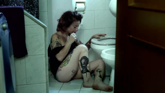 violence on woman - wounded woman takes care of wounds in the bathroom video