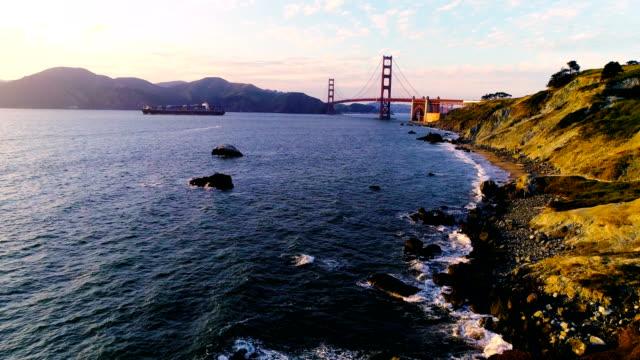 Virbant Sunset Over San Francisco Bay Harbor Golden Gate Bridge and Cargo Ship