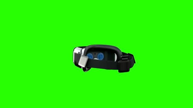 vídeos y material grabado en eventos de stock de auriculares de realidad virtual dando vueltas en la pantalla verde - copiar