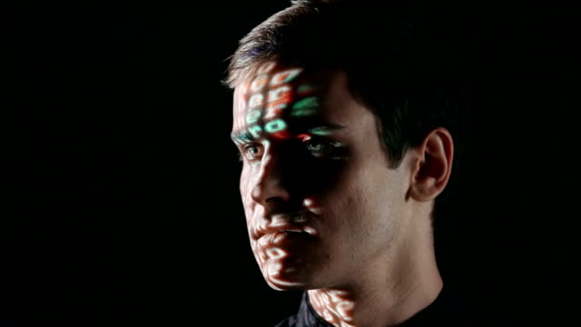 Virtual Reality Man chuckling with binary code projected on his face identity theft stock videos & royalty-free footage
