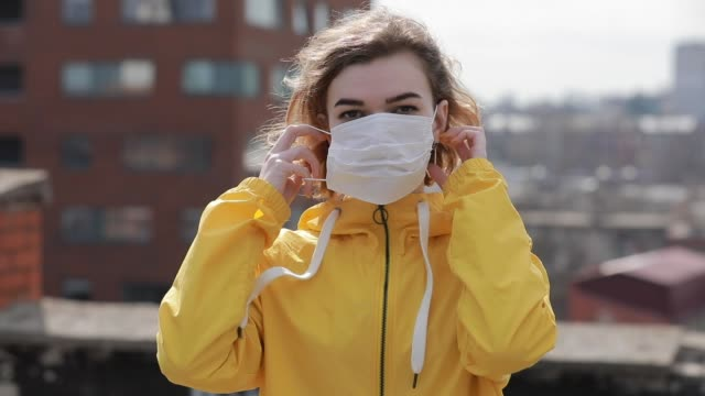 Virus epidemic, woman wearing face mask on the roof of city video