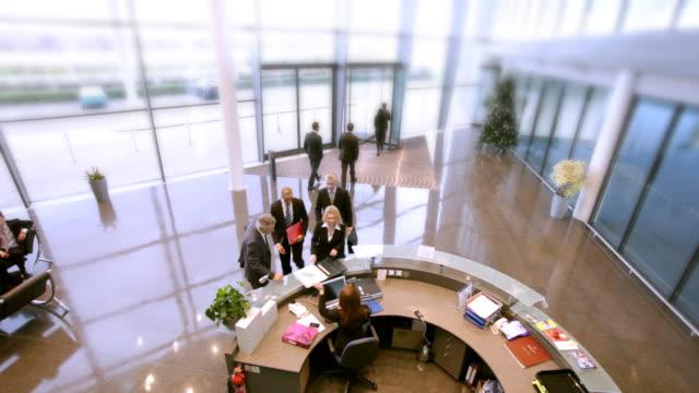visiting offices - hotel reception stok videoları ve detay görüntü çekimi