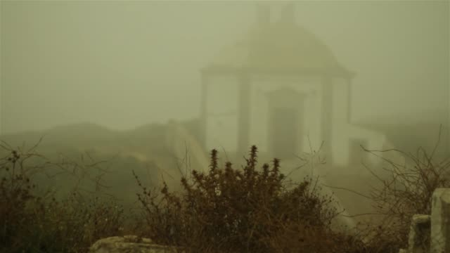 Visiting old monastery covered in thick fog