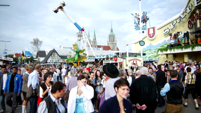 visitors on oktoberfest fairgrounds (4k/uhd to hd) - oktoberfest stock videos and b-roll footage