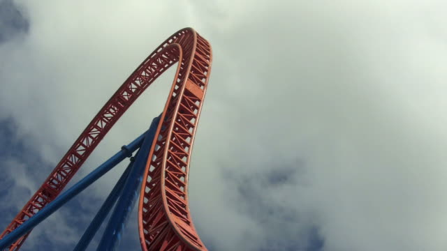 visitors ride on rollercoaster - roller coaster stock videos & royalty-free footage