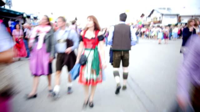 POV T/L Visitors Walking Through Oktoberfest Fairgrounds video