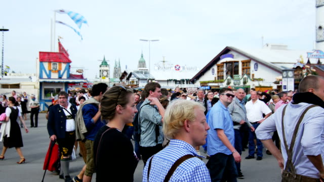 Visitors Walking Through Oktoberfest Fairgrounds (4K/UHD to HD) video