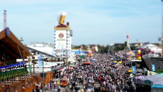 visitors walking walking through oktoberfest fairgrounds - oktoberfest stock videos and b-roll footage