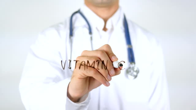 Vitamin C , Doctor Writing on Glass video