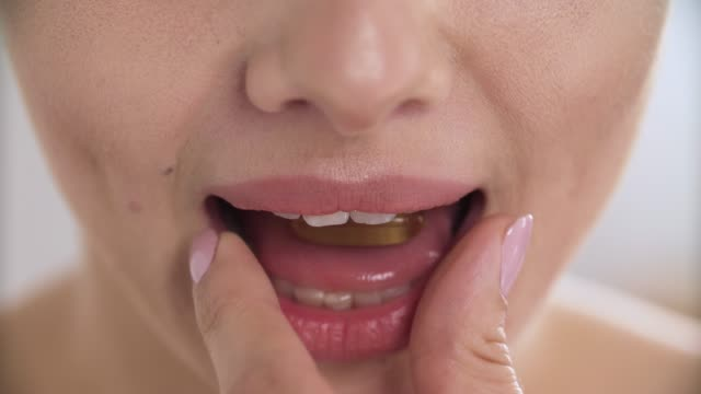 vitamin. healthy woman taking diet supplement closeup - vitamina video stock e b–roll