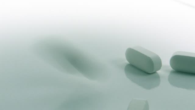 Vitamin Pills Falling on White video