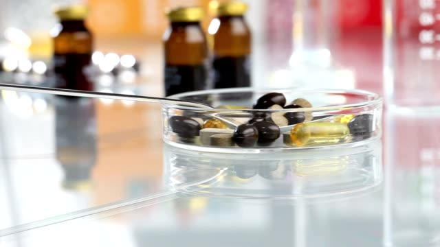vitamins supplements pills omega 3 in spoon video