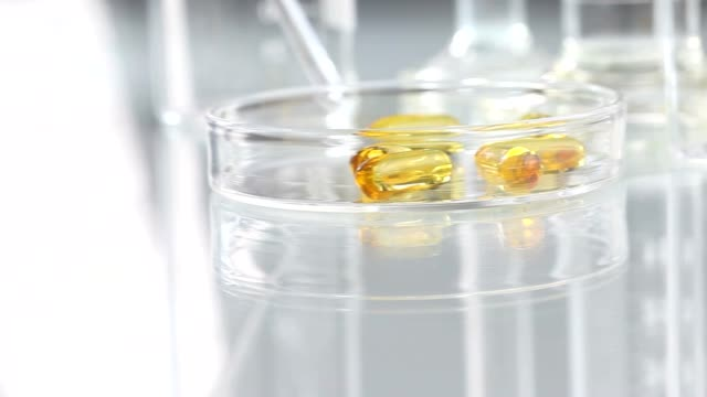 vitamins supplements pills omega 3 on table - vitamin d stok videoları ve detay görüntü çekimi
