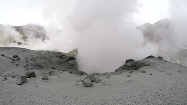 Volcanic activity - boiling thermal mud pot in crater active volcano video