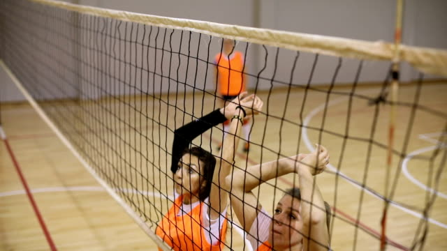 Volleyball blocking Women volleyball team training indoors, girls jumping in block. volleyball ball stock videos & royalty-free footage