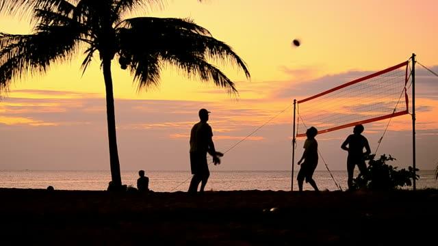 volleyball on sunset beach video