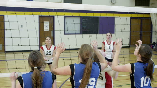Volleyball Girls high school volleyball game. volleyball sport stock videos & royalty-free footage